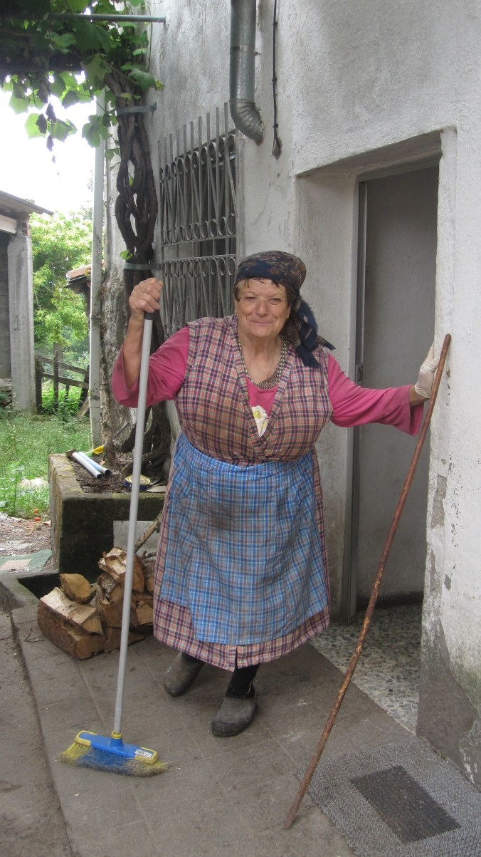 Galician woman cleaning her house