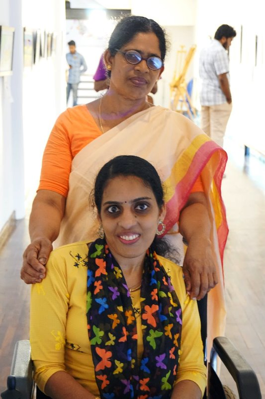 Remya Ganesh Wheelchair Model With Mother
