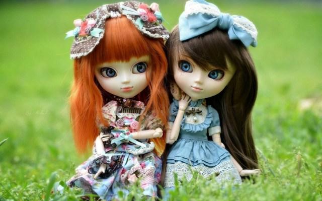 lovely siblings barbie doll in garden