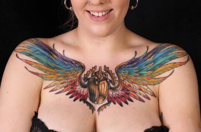 winged scarab chest tattoo