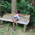 girl on bamboo bench Mayfield Falls Jamaica