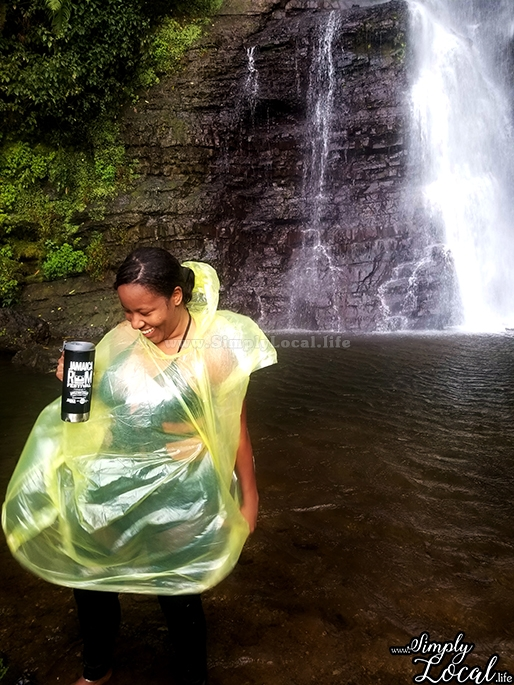 girl in raincoat at waterfall