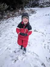 Ryan is gleeful after pelting the photographer with a snow ball!