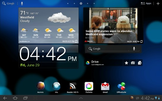 An Android home screen featuring apps and widgets.