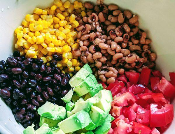 bowl with black beans corn, pinto pbeans, avocado and tomato