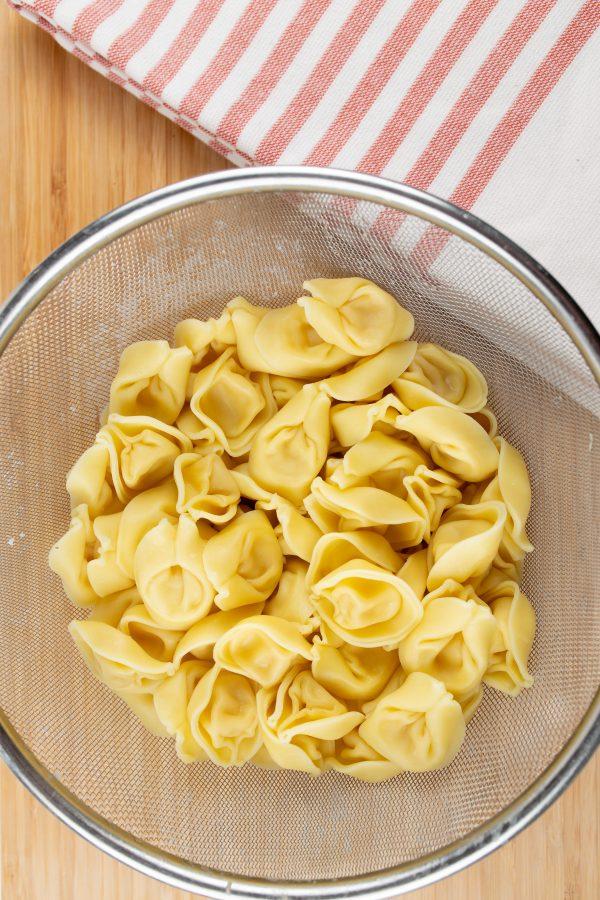 tortellini in a strainer