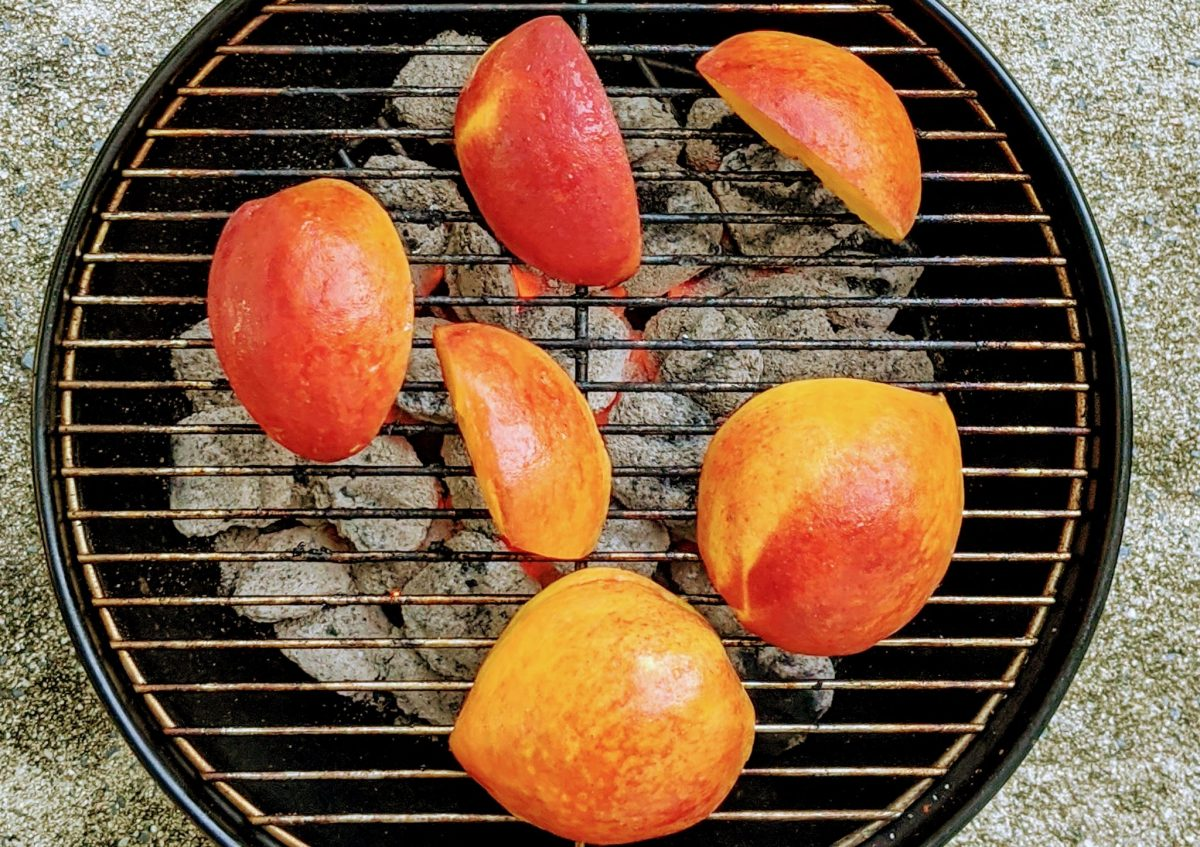 birds eye view of peaches on grill
