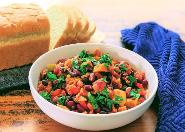 instant pot sweet potato chili in a bowl by bread