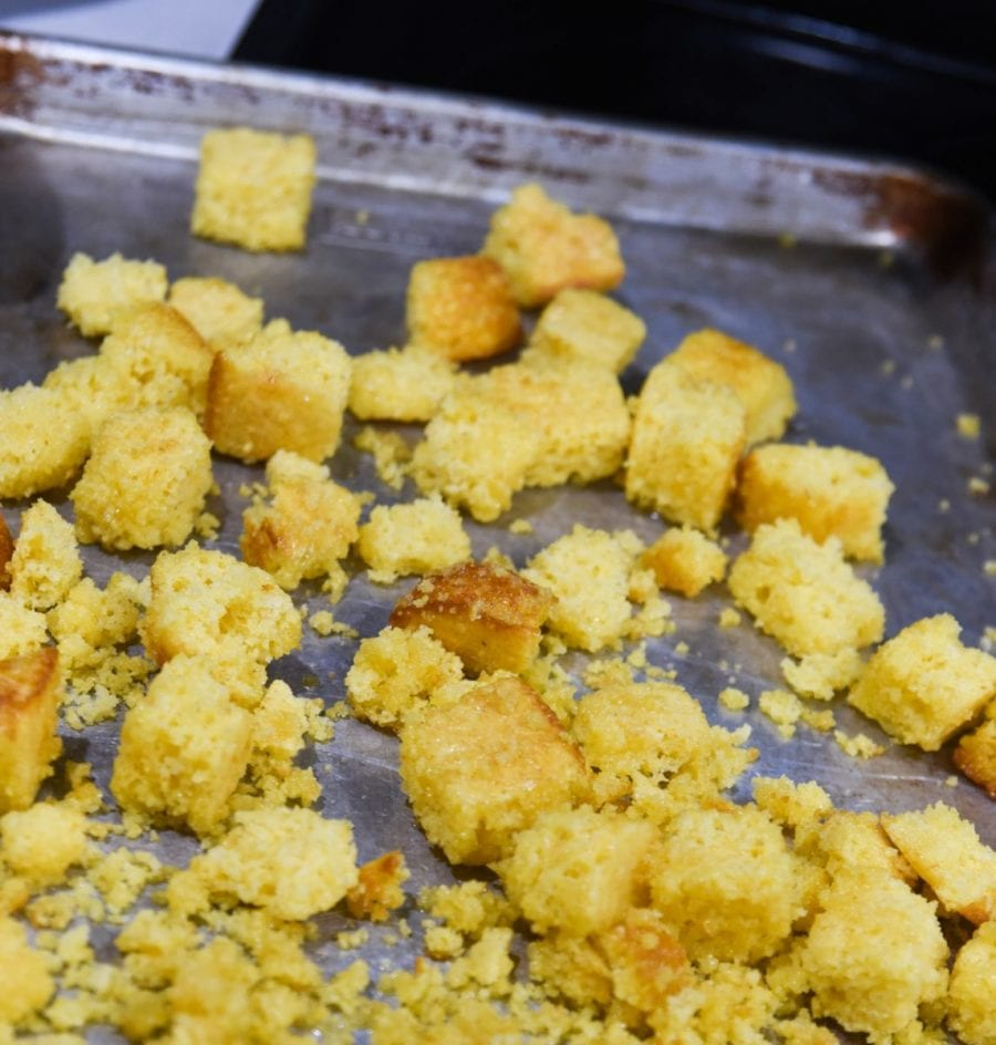 cornbread croutons on pan