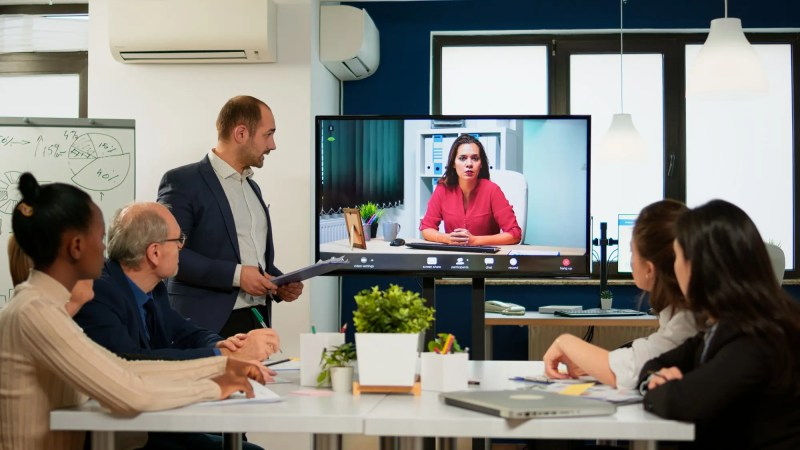 Project manager presenting company ceo discussing on at webcam