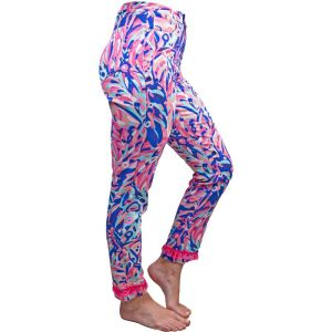 Vibrant   pinks and blues abstract leaves print fitted pants with 2 front pockets, 2   back pockets, a button and zipper front closure, and a pink tassel bottom   accent.