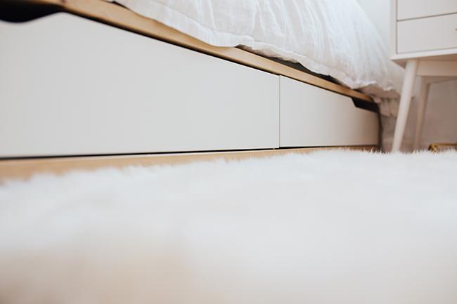 HOW TO ORGANIZE AN APARTMENT USING THE KONMARI METHOD // Mari Kondo // pretty apartment decor // white bedroom details // minimalist style // bedroom storage // SimplySpaced.com