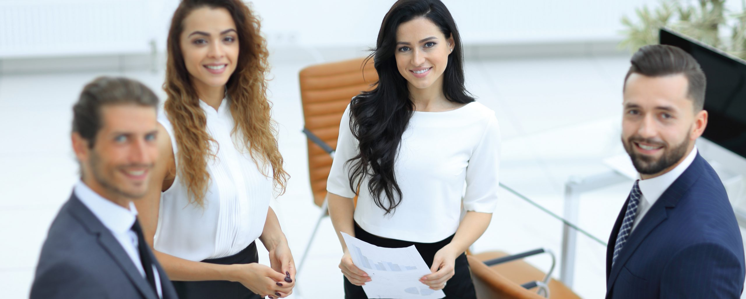 successful employees standing in a modern office