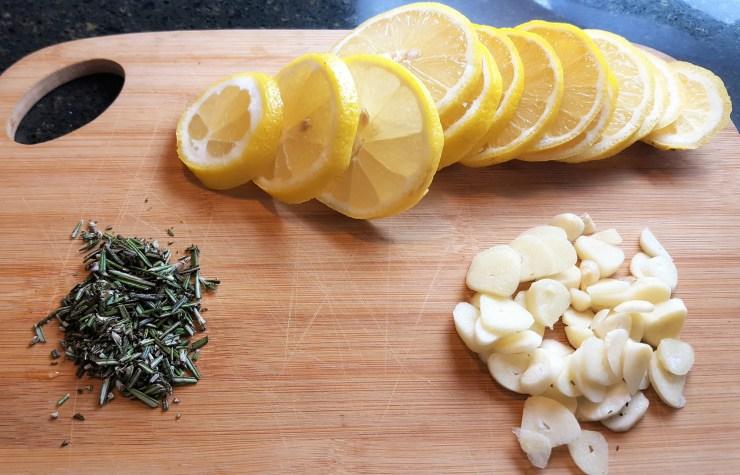 A sheet pan of shrimp in a garlic butter sauce with lemon & fresh herbs