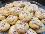 A tray of Italian Ricotta Cookies with icing and colored sprinkles