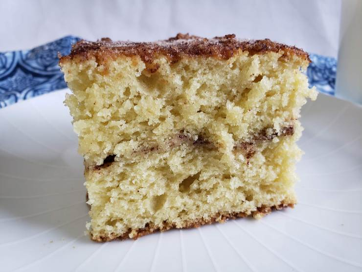 A light, moist Sour Cream Cake with a layer of cinnamon-sugar swirl hidden inside with a sweet, crisp caramelized topping