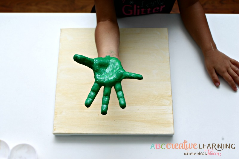 Shamrock Handprint Canvas Craft for Kids for the month of March