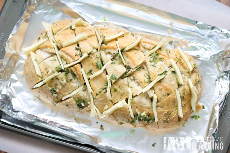Easy Cheesy Garlic Pull Apart Bread and NESTLÉ® STOUFFER'S® Family Size Entreés prep