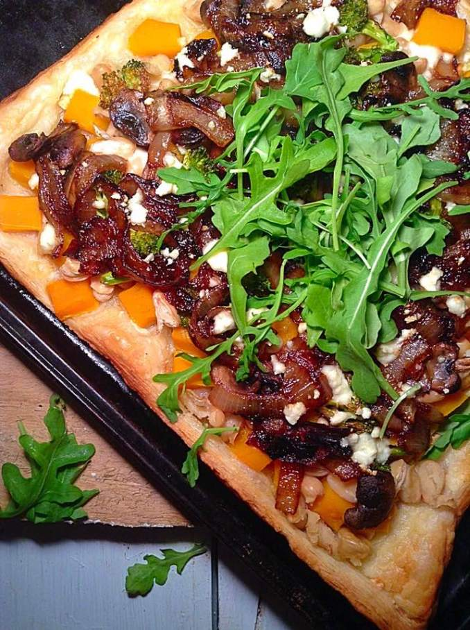 Caramelized onions and squash pizza