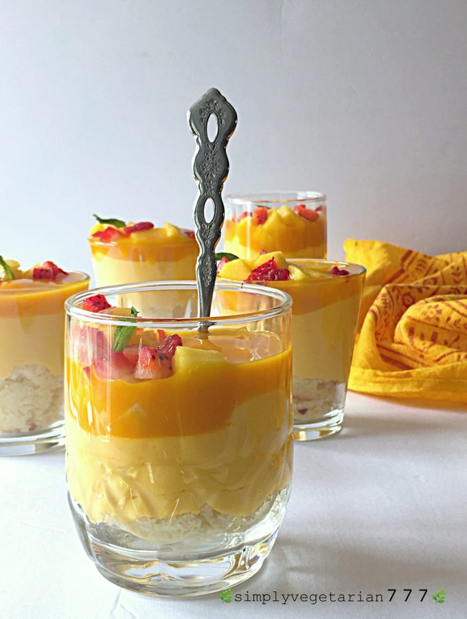 This Mango Cheesecake Trifle is very easy to make and super delicious. Most important part is that it is a No-Cook and No-Bake Recipe. It is a perfect dessert for your parties and get-togethers. #mangorecipes #cheesescake #mangocheesecake #nobakecheesecake #nocookcheesecake #triflerecipes #easydessert #mangodessert #cheesecake #summerdessert #nutfreedessert #easytrifle #partydessert #easycheesecake #nocookdessert