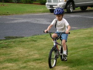 boy riding bike