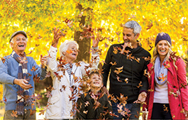 family playing in leaves