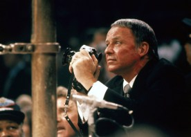 Frank Sinatra, shooting the Joe Frazier versus Muhammad Ali fight for LIFE magazine, holding his camera ringside at Madison Square Garden. New York, New York 3/8/1971 (Image # 1145 )