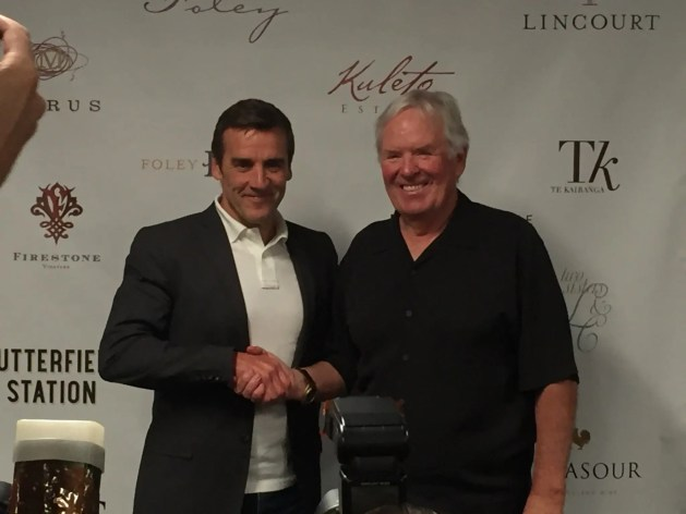 George McPhee and Bill Foley shake hands at a press conference on Jily 13th, 2016 at T-Mobile Arena announcing McPhee as the team's first GM.