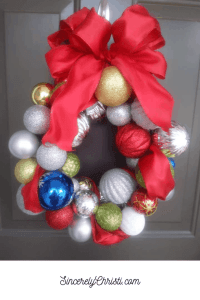 Christmas Ball Wreath on the front door with text overlay SincerelyChristi.com