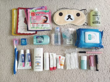 Face + eye masks (thanks Tracy and Lester!), laundry wash, dental kit, deodorant, contacts kit, wet/makeup remover wipes, 2-in-1 shampoo and travel cream samples, Q-tips, makeup kit. Missing my razor, which I'm still using atm.