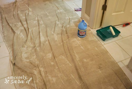 Applying starach to fabric for wall