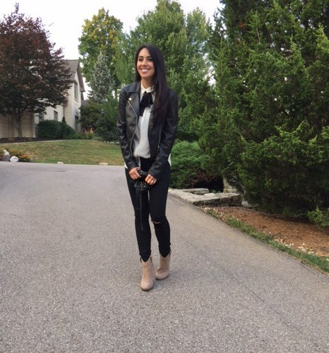 faux leather jacket, blouse with bow, distressed denim cutouts, ankle boots
