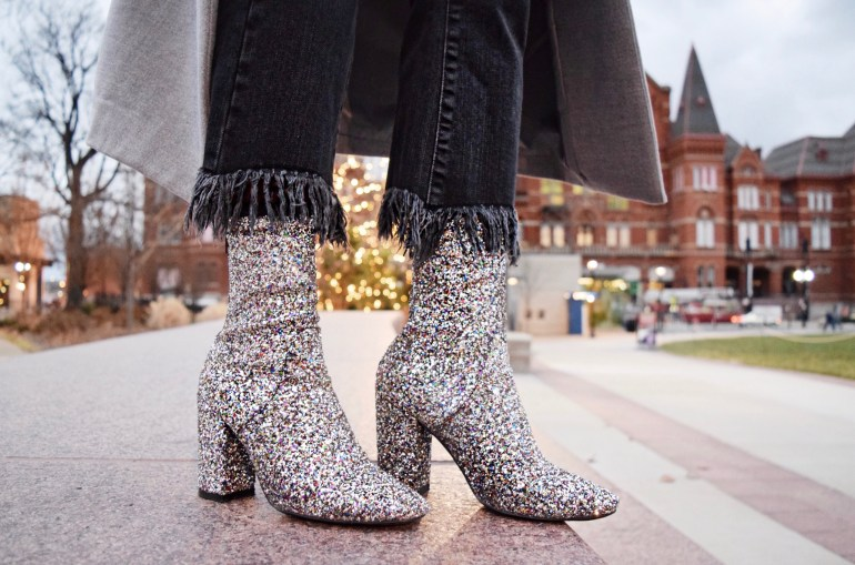 sparkle ankle boots and black fringe jeans in front of music hall