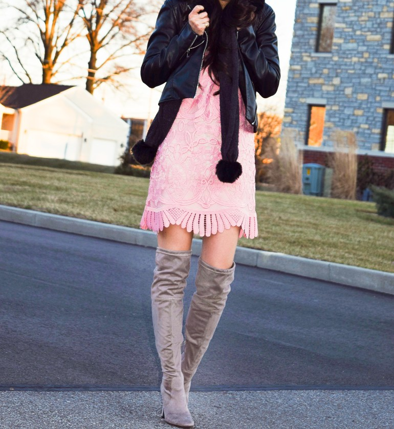 lace detail shift dress in pale pink, black faux leather jacket, black pom scarf