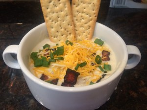 Slow cooke loaded baked potato soup topped with Reid's smoked bacon, green onions, & cheese