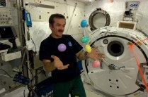 Col. Chris Hadfield juggles the Easter eggs he's brought to space for his co-astronauts. Photo shared by Col. Chris Hadfield.