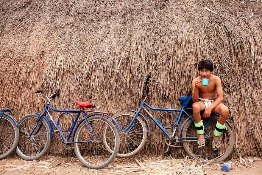 Indigenous man sat on a bike
