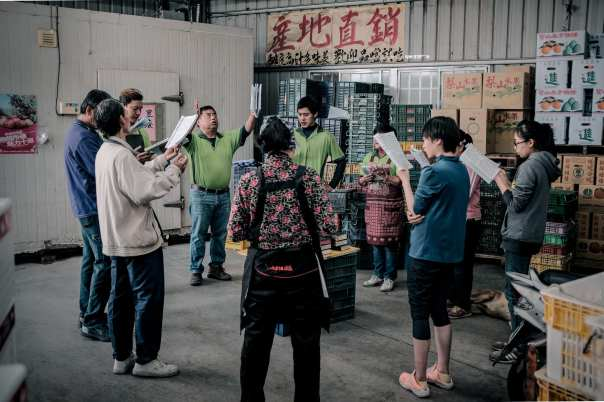 Staff members of a local Christian fruit store pray before work