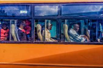 Passengers on board an early bus in Kibera to the city centre. November 1, 2016. © Brian Otieno