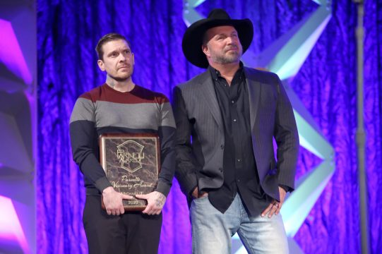 ANAHEIM, CALIFORNIA - JANUARY 17: Brent Smith and Garth Brooks onstage at The 2020 NAMM Show on January 17, 2020 in Anaheim, California. (Photo by Jesse Grant/Getty Images for NAMM)