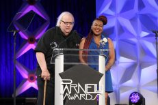 ANAHEIM, CALIFORNIA - JANUARY 17: George Petersen and Amanda Davis speak onstage at The 2020 NAMM Show on January 17, 2020 in Anaheim, California. (Photo by Jesse Grant/Getty Images for NAMM)