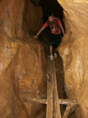 Vang Vieng Inside a cave scaled - What to do in Vang Vieng: the best 3 things