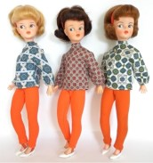 Sindy 's blouse and ski pants with kitten heels of course!