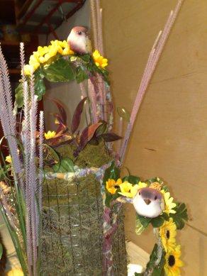 Blumengesteck Kanne