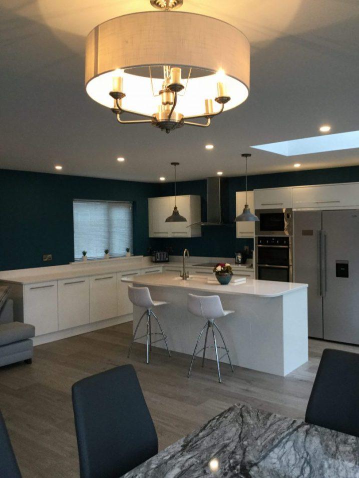 Kitchen design-White matt kitchen teamed with Fleetwood Teal colour walls.