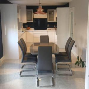 Kitchen redesign-White Gloss kitchen teamed with Colourtrend Mussel & copper lighting