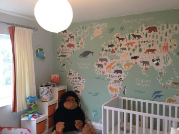 Childs bedroom design with world map mural