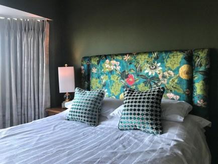 Bedroom design with dark green walls
