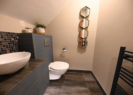 Guest bathroom with concealed cistern