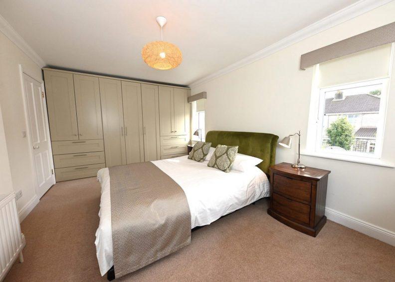 Bedroom design- green velvet besoke headboard
